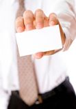 Business man holding visiting card Royalty Free Stock Photo