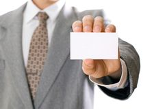 Business man holding visiting card Royalty Free Stock Photos
