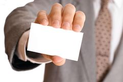 Business man holding visiting card Stock Images