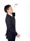 Business man holding a white board Royalty Free Stock Images