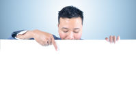 Business man holding white board. With sign on the white board Royalty Free Stock Photography
