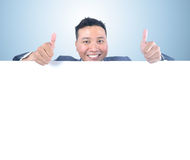 Business man holding white board. With thumb up Royalty Free Stock Photos