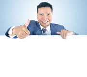 Business man holding white board. With thumb up Royalty Free Stock Image