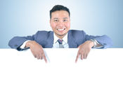 Business man holding white board Stock Photo
