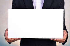Business man holding white box Stock Photos