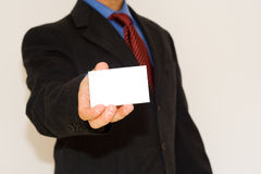 Business man holding a white card. (focus on the card Royalty Free Stock Photography