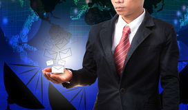 Business man holding white envelope of data and information with. Graphic blue world map Stock Image