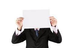 Business man holding a white paper. Isolate on white Royalty Free Stock Photos