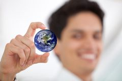 Business man holding the world Stock Image