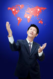 Business man holding world map Royalty Free Stock Photography