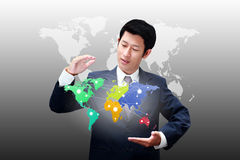 Business man holding world map Stock Photo