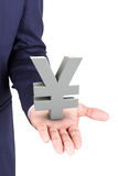 Business man holding yen currency symbol Stock Photo