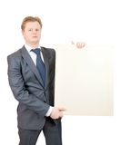 Business Man Holds Blank Canvas Royalty Free Stock Photography