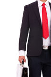 Business man holds briefcase Royalty Free Stock Image