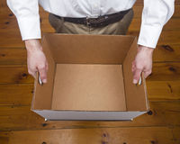Business Man Holds Empty Box Stock Photo