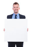Business man holds empty plank Royalty Free Stock Images