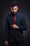 Business man holds hand on suit lapel royalty free stock image