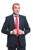 Business man holds hands on jacket Stock Photography