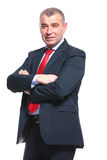 Business man holds his arms folded royalty free stock photo