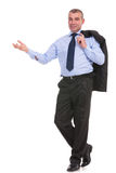 Business man holds his jacket on his shoulder and smiles Stock Images