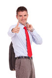 Business man holds his jacket and ok sign Royalty Free Stock Image