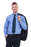 Business man holds his jacket on shoulder and smiles Stock Photos