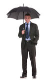 Business man holds his umbrella Stock Photography