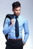Business man holds jacket on shoulder Stock Images