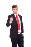 Business man holds a marker Royalty Free Stock Image