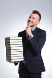 Business man holds a pile of books Stock Images