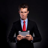 Business man holds tablet Royalty Free Stock Photo