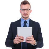 Business man holds a tablet Royalty Free Stock Photo