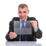 Business man holds a transparent pannel Stock Image
