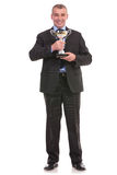 Business man holds a trophy Royalty Free Stock Images