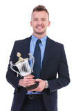 Business man holds a trophy Royalty Free Stock Photos