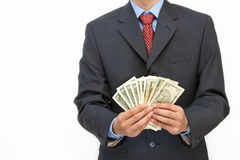 Business man holidng money Stock Photo
