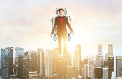 Business man hover over city skyline. Business Advantage. Businessman in sketch astronaut costume hovering over down town on sunset Royalty Free Stock Image