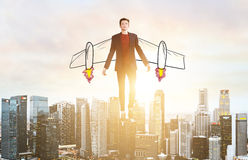 Business man hover over city skyline Stock Photo