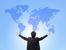 Business man hug global map. Blue background, back view, concept for globe business, asian people stock image