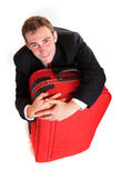Business man hug luggage Royalty Free Stock Images