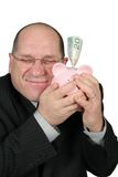 Business Man Hugging Piggy Bank Royalty Free Stock Images