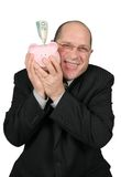 Business Man Hugging Piggy Bank Stock Photos