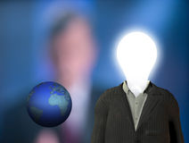 Business man idea. Bulb head Business man, the earth, blurred figure Royalty Free Stock Photo