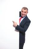Business man indicating on panel Royalty Free Stock Image