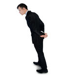 Business man inspecting something Royalty Free Stock Photography