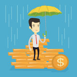 Business man insurance agent with umbrella. Asian business man insurance agent with umbrella. Insurance agent holding umbrella over golden coins. Business royalty free illustration