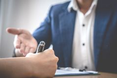 Business man is inviting partner to sign the agreement business deal. Business men hand is inviting partner to sign the agreement business deal Stock Photos