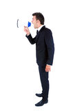 Business man isolated. Isolated young business man with loudspeaker Royalty Free Stock Images