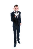 Business man isolated. Isolated young business man with loudspeaker Stock Images