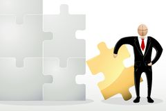 Business Man with Jigsaw Puzzle Stock Photos